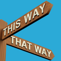 This Or That Way Directions On A Wooden Signpost